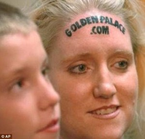 Karolyne Smith, who is American, tattooed her head for $10,000.